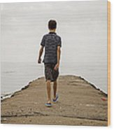 Boy Walking On Concrete Beach Pier Wood Print
