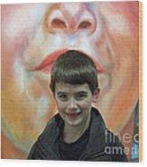 Boy With His Portrait Wood Print
