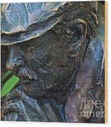 Bronze Man Sitting Wood Print
