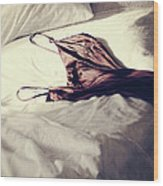 Brown Negligee Laying Across Sheets On Bed Wood Print by Sandra Cunningham