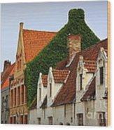 Bruges Rooftops Wood Print by Carol Groenen