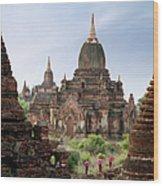 Buddhist Monks Walking Past Temple Wood Print