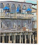 Building On Piles Above Water Wood Print by Lorna Maza