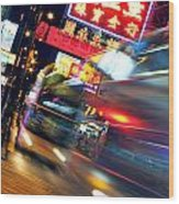 Bus Race In Mong Kok Wood Print by Lars Ruecker