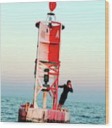 Business Woman On A Buoy Wood Print