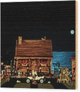 Log Cabin Near The Ocean At Midnight Wood Print by Leslie Crotty
