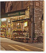 Cafe In Assisi At Night Wood Print by Susan Schmitz