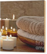 Candles And Towels In A Spa Wood Print by Olivier Le Queinec