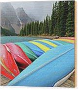 Canoes Line Dock At Moraine Lake, Banff Wood Print