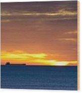 Cargo Ship On Horizon At Dawn Wood Print