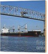 Cargo Ship Under Bridge Wood Print