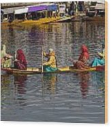Cartoon - Ladies On A Wooden Boat On The Dal Lake With The Background Of Hoseboats Wood Print