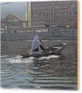Cartoon - Light Following This Lady On A Wooden Boat On The Dal Lake In Srinagar Wood Print