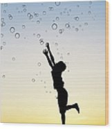 Catching Bubbles Wood Print