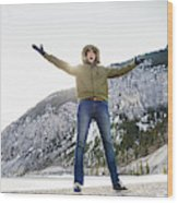 Caucasian Man Cheering In Snowy Field Wood Print