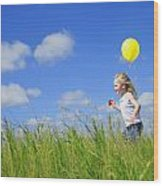 Child Running With A Balloon Wood Print