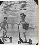 Children Playing Under Water Wood Print