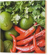 Chillies And Limes Wood Print