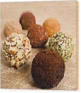 Chocolate Truffles On Gold Wood Print