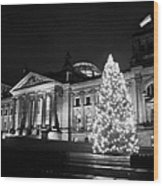 christmas tree and german flag flying fluttering on flagpole outside reichstag building Berlin Germany Wood Print