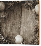 Christmas Wreath With Ornaments And Pine Cones On Rustic Wood Ba Wood Print