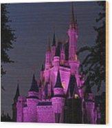 Cinderella Castle Illuminated In Pink Glow Wood Print