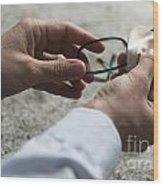 Cleaning Her Eyeglasses Wood Print