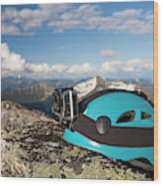 Climbing Helmet With Camera On Mountain Wood Print