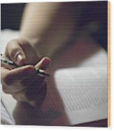Close-up Of A Hand Holding A Pen Wood Print