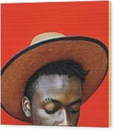 Close-up Of Man Wearing Hat Against Red Wood Print