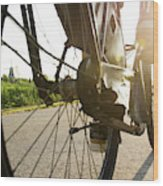 Close Up Of Wheel Of Bicycle On Road Wood Print