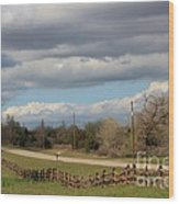 Cloudy Sky With A Log Fence Wood Print