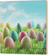 Colorful Easter Eggs In A Field Of Grass Wood Print by Sandra Cunningham