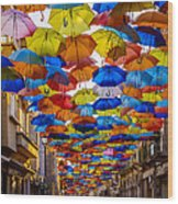 Colorful Floating Umbrellas Wood Print by Marco Oliveira