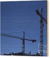 Construction Cranes At Dusk Wood Print