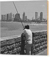 Contemplative Fisherman In Tel Aviv Wood Print