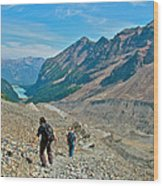 Couple Hiking On Plain Of Six Glaciers Trail  In Banff Np-albert Wood Print