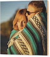 Couple Wraps Themselves In A Blue Wood Print
