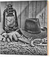 Cowboy Hat And Rodeo Lasso In A Black And White Wood Print by Paul Ward
