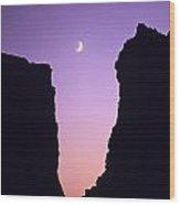 Crescent Moon Between Rock Formations Face Rock Wood Print