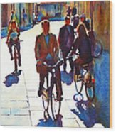 Cycling In The City Wood Print