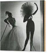 Dancers Posing In Costumes From Salvador Dali's Wood Print