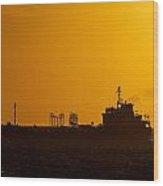Dark Boat Silhouette At Sunset Wood Print