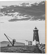 Davit And Lighthouse On A Breakwater Wood Print