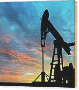 Dawn Over Petroleum Pump Wood Print