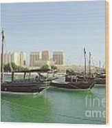 Dhows And Doha Port Buildings Wood Print