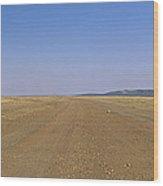 Dirt Road Passing Through A Landscape Wood Print