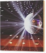Disco Ball At Illuminated Nightclub Wood Print
