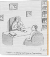 Doctor Speaks To Patient Over Desk Wood Print by Zachary Kanin