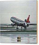 Douglas Dc-10-40 Taking Off In The Rain Wood Print by Wernher Krutein